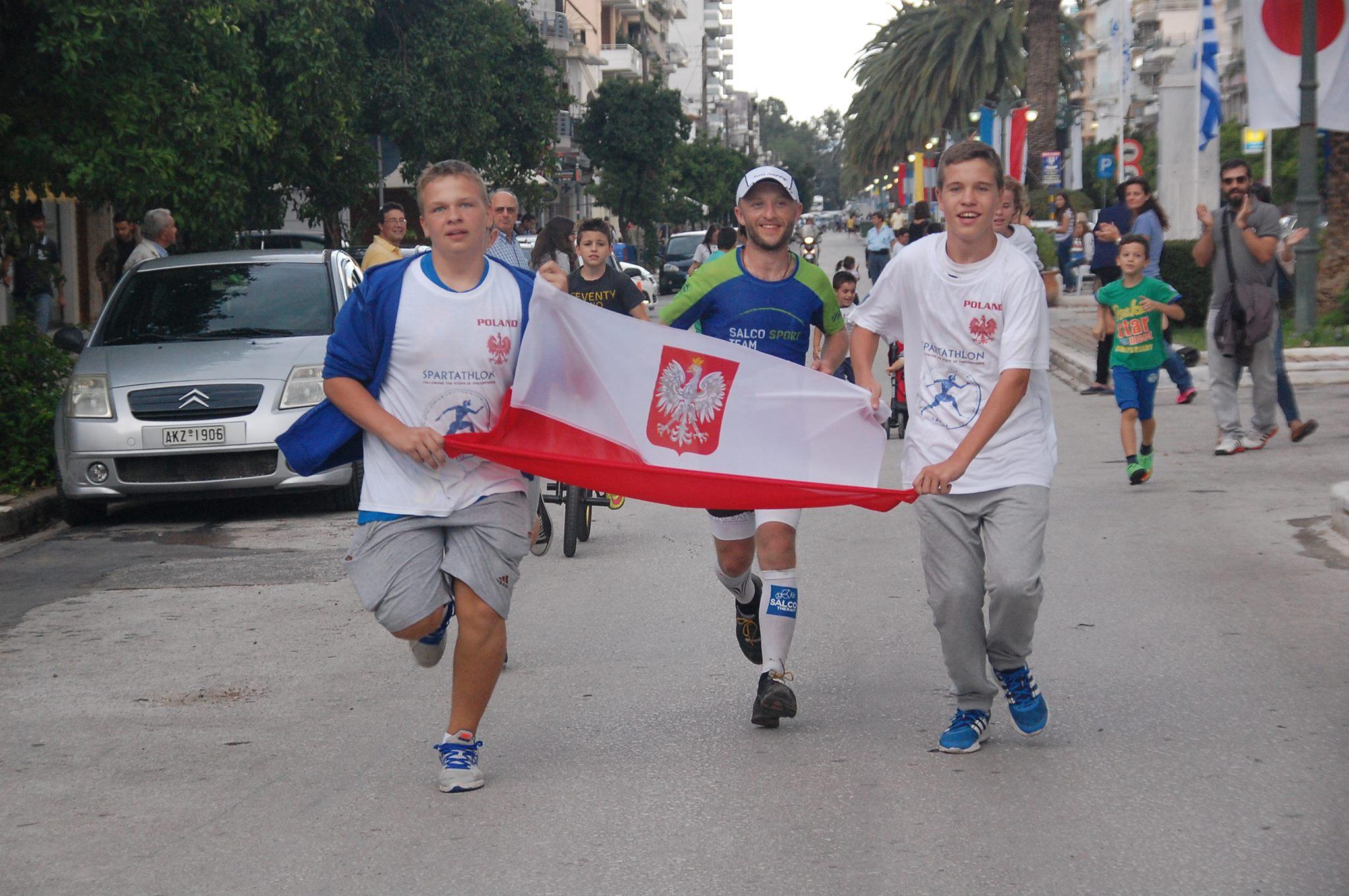 Łukasz Sagan z polską flagą